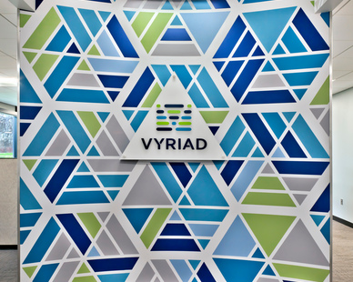 The signage for the Vyriad offices also works as an office divider to give privacy to employees but also brand the space.