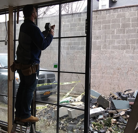 Interior view of Fixed windows being installed, fastening them to each other to form a Window Wall.