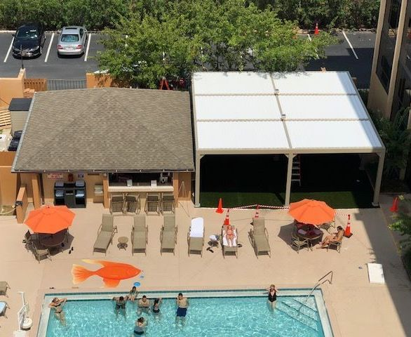You can enjoy the pool in the shade under this new Equinox Louvered Roof.