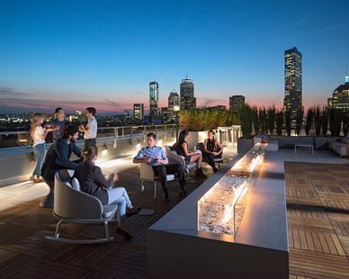 One of the 345 Harrison apartment's amenities is a twelve-person firepit with glass details that express the building's upscale vibe. Bison 2x2 Smooth Ipê Wood Tilesover Bison Versadjust Pedestals were specified for many of the modern rooftop spaces to provide modularity.