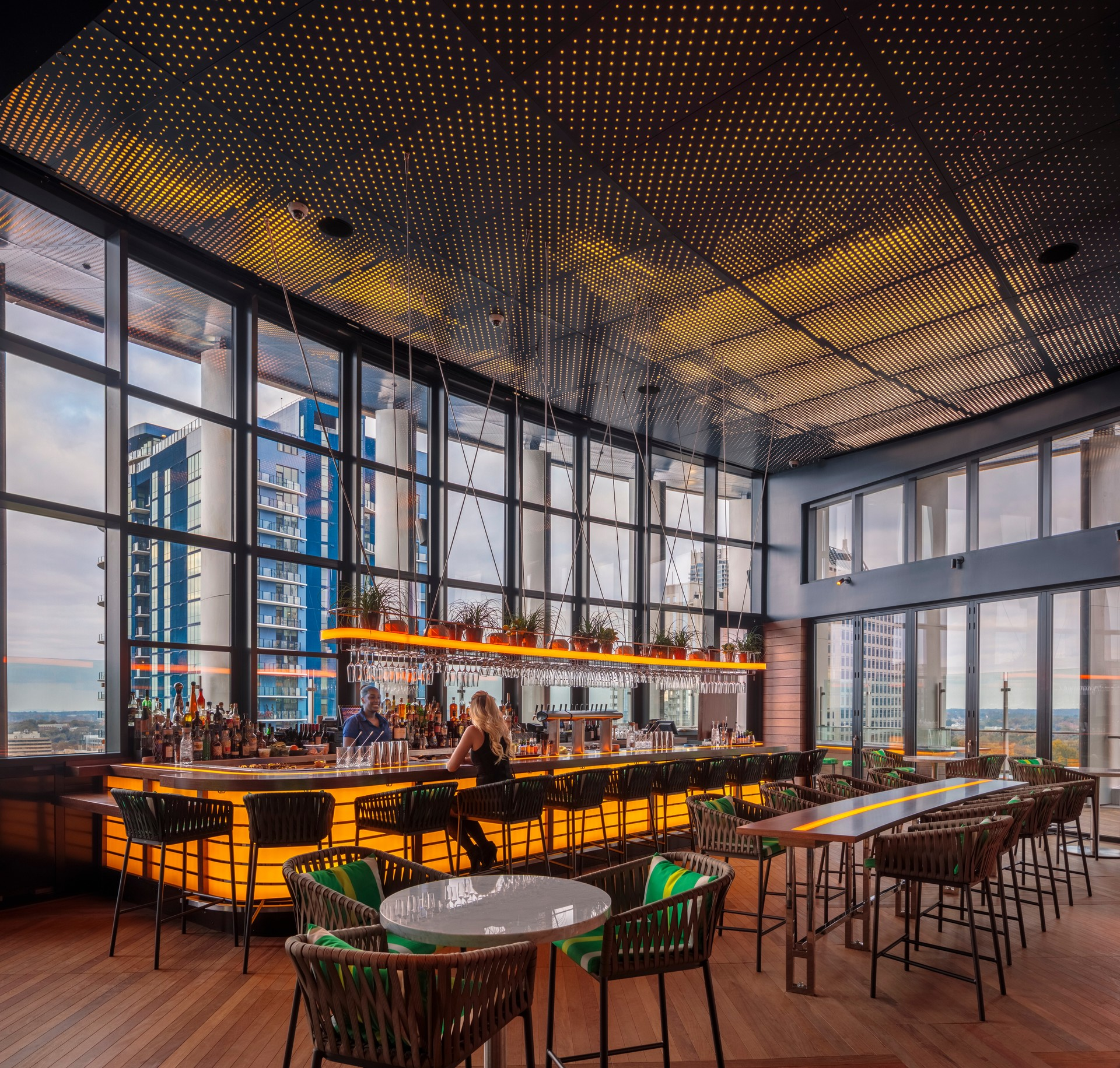 Bison's modular Ipê Wood Tiles complement the aesthetics of the Kimpton Tryon Park Hotel rooftop bar and set the contemporary look, allowing for warm accessories and modern touches.   Photography Credit: Brad Feinknopf/OTTO