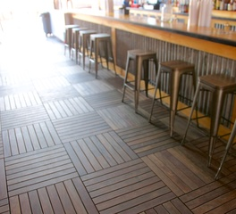 Bison Innovative Products Nudies Honky Tonk Raised Wood Bar Flooring