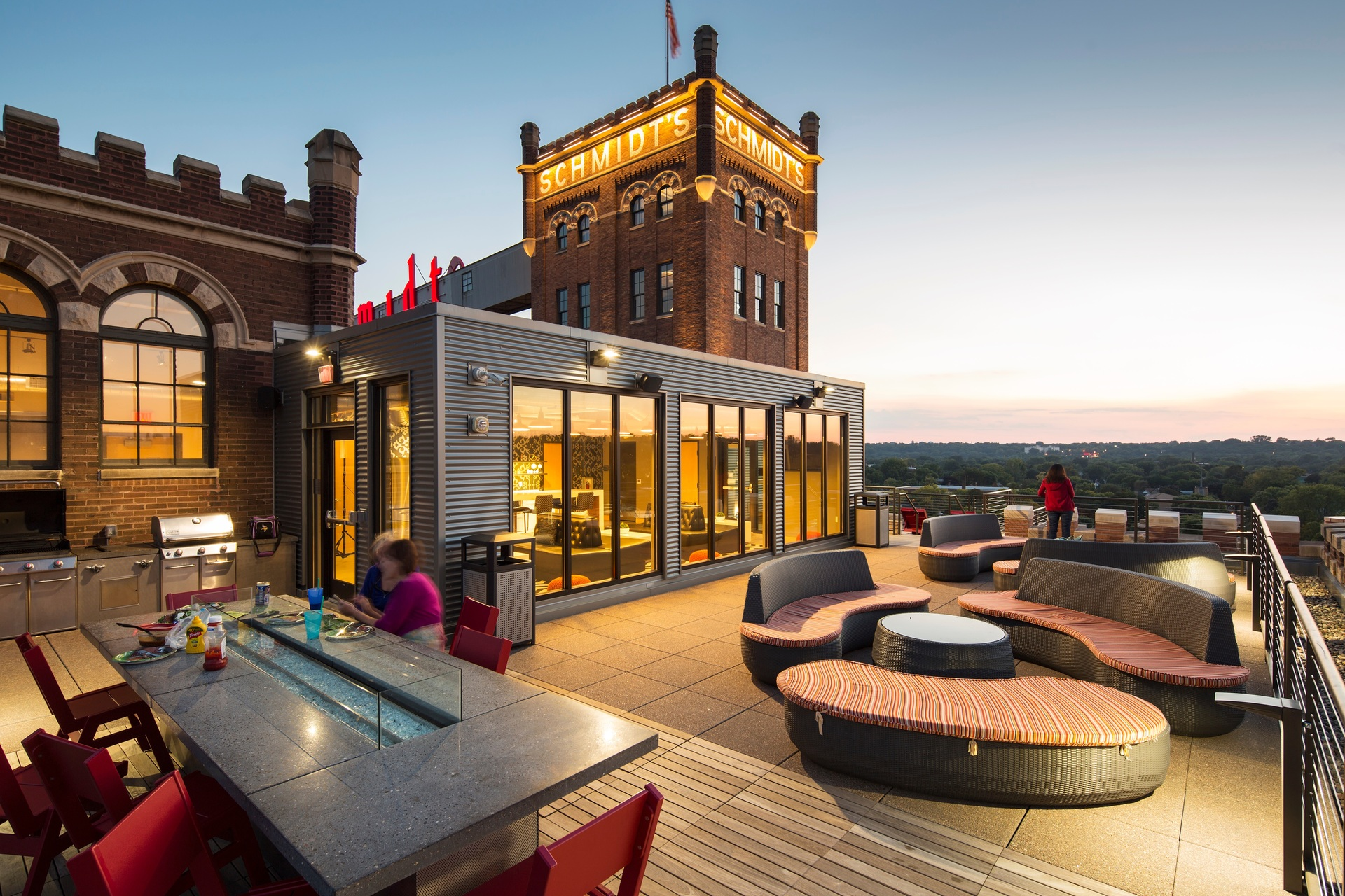 BKV Architects used Bison Wood Deck Tiles to provide an inviting, modern retreat to relax on the rooftop of the new Schmidt Artist Lofts. The modular deck tiles and adjustable pedestals gave the team design flexibility for the unique space.  Photography Credit: Troy Theis