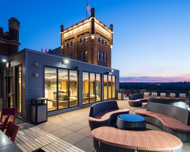 Bison Innovative Products Ipê Wood Deck Tile and Versadjust Pedestal System were used to help create the stunning rooftop patio at the Schmidt Artist Lofts in Minneapolis, Minnesota.  Photography Credit: Troy Theis