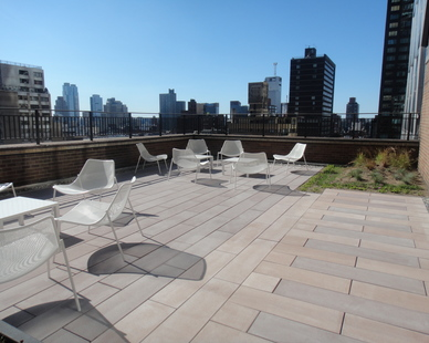 Bison Innovative Products Pedestals were used to support the beautiful concrete pavers on the newly transformed setback on the 9th-floor of the Symphony House.
