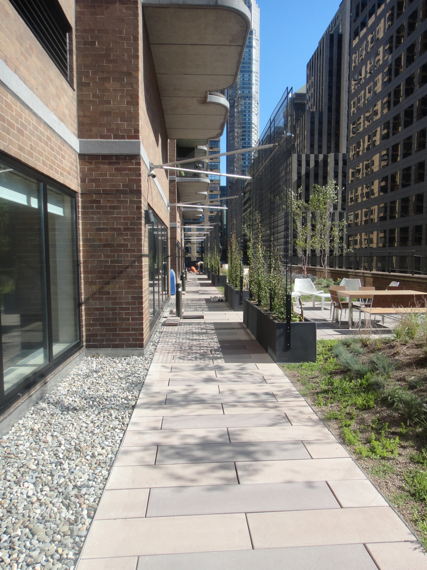 The Symphony House 9th floor setback was recently transformed into a 12,000 sq ft eco-friendly tenant amenity, featuring attractive pavers supported by Bison Pedestals, planting areas, trees, scrubs, and seating areas.