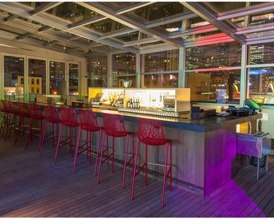 The 15,000 square foot rooftop space, home to an indoor/outdoor bar is available for events year-round and includes panoramic views, a fire pit, shimmering water features, a video wall, and retractable roof.