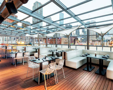 The foundation of this 15,000 square foot chic space was created using Bison Versadjust Pedestals and 2×4 Ipê Smooth Wood Tiles for the deck surface.