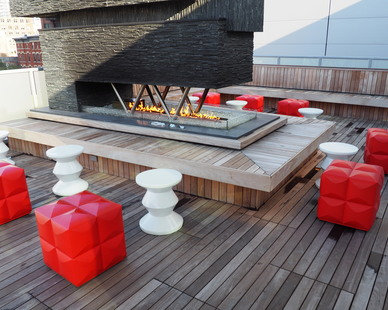 The foundation of The Godfrey Hotel's 15,000 square foot rooftop patio was created using Bison Versadjust Pedestals and 2×4 Ipê Smooth Wood Tiles for the deck surface.