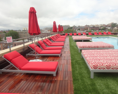 Bison Versadjust Pedestals support Ipê Wood Tiles and artificial turf over the grating of the stunning new Vida Fitness Penthouse Rooftop.