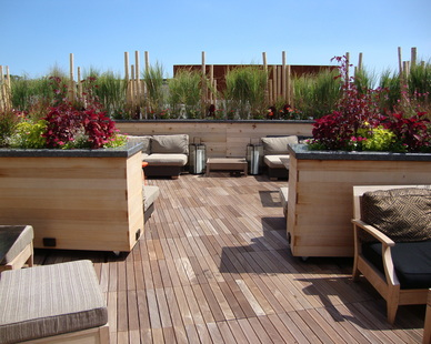 The Wilde & Greene Restaurant features a stunning rooftop patio supported by Bison Versadjust Deck Pedestal System with Ipê Wood Pavers.