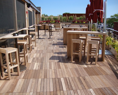 The rooftop patio at the Wilde & Greene Restaurant features an expansive patio using Bison wood tiles supported by their Versadjust deck supports.
