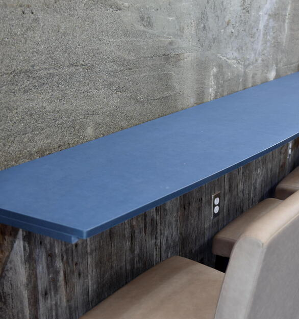 Azure is one of PaperStone's designer colors, engineered to be durable, stain resistant, and easily machined and installed. PaperStone is made out of recycled paper and a petroleum-free resin, making it an earth-friendly option suitable for any application.