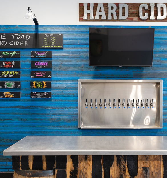 Hard Cidery in Rochester, NY uses paneling from Pioneer Millworks. This blue wooden feature wall uses Shou Sugi Ban in Larch Cobalt. 