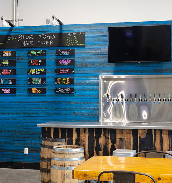 This Rochester, NY Cidery/Brewery leveraged Pioneer Millwork's Shou Sugi Ban line in Larch Cobalt to enhance the look of the bar and menu board.