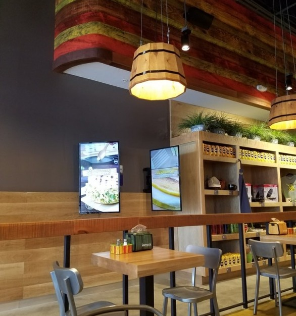 Bock Lighting created custom wooden drum light fixtures that are used throughout this restaurant.