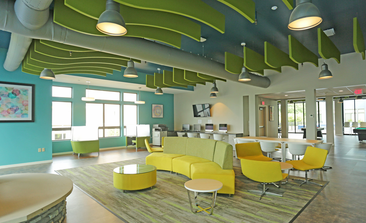 The clubhouse at the Auden Albany apartments in Albany, New York features stunning light fixtures by Bock Lighting.