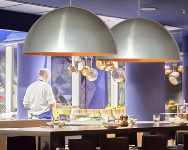 The Beretto aluminum spinning decorative reflector, by Bock Lighting, looks beautiful in this Buffalo Wings and Rings restaurant.