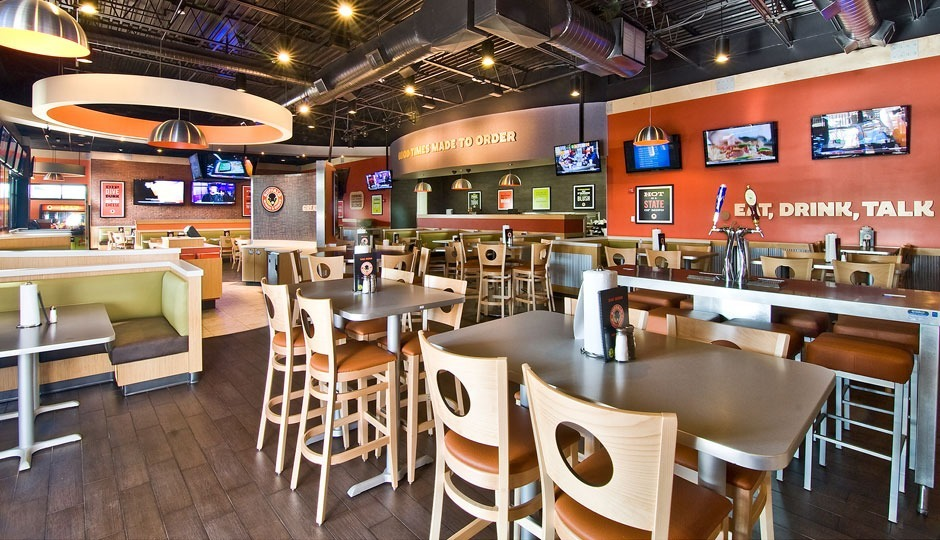 The Beretto Aluminum Spinning light fixture can be found throughout this Buffalo Wings and Rings restaurant.