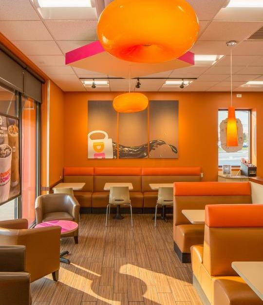 Custom hand-blown European glass chandeliers were created by Bock Lighting and used throughout this Dunkin' Donuts location.