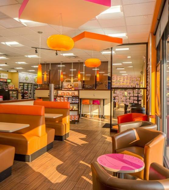 Custom donut-shaped, Bock Lighting chandeliers can be found throughout this Dunkin' Donuts location.
