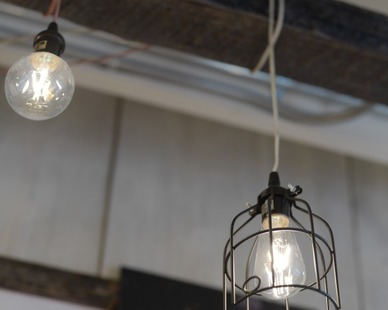 Custom hanging light fixtures, from Bock Lighting, were used throughout the FatFace retail store.