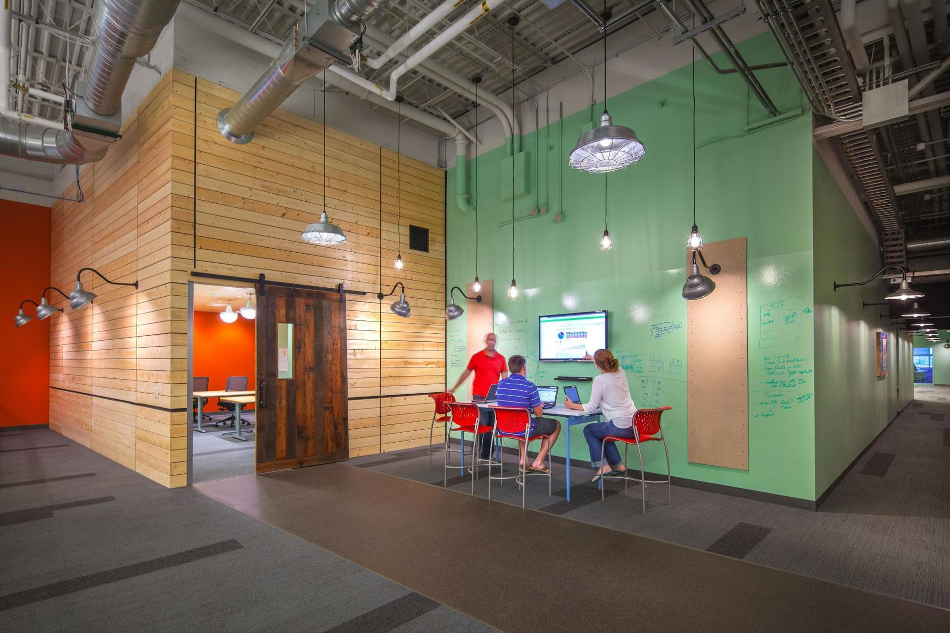 Open office space can be found at The Paradigm offices, with lighting completed by Bock Lighting.
