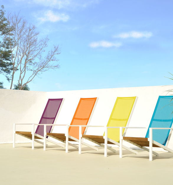 A modern take on the classic Adirondack chair. Sleek angles give a modern look but sacrifice none of the comfort. A reclaimed teak seat is held in place by a sturdy aluminum frame in your choice of powder coat colors. Personalize the back by choosing from a variety of durable Batyline mesh colors.