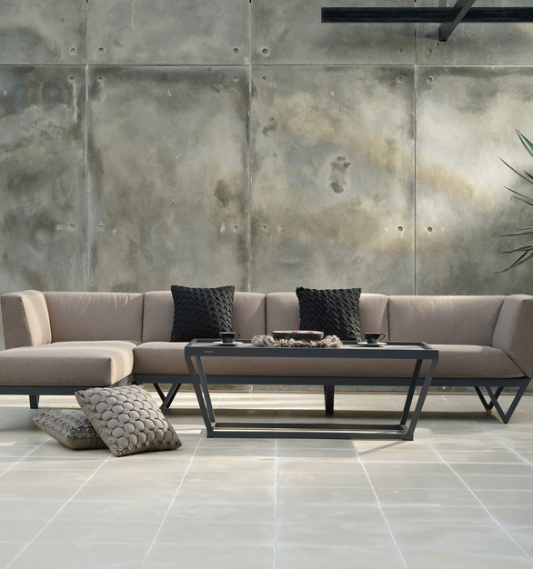 The overwhelming beauty and casual elegance of Sydney Australia was the inspiration for this collection. Deep seating invites guests to relax and lounge on crisply tailored cushions that sit atop a durable hand welded aluminum frame. All cushions feature our quick drain technology and are covered in your choice of durable Sunbrella fabrics or waterproof Agora fabrics. Integrated side tables are topped with High Pressure Laminate (HPL) or reclaimed teak and are available on select sectional components. The daring angles create a striking visual interest and the modular back cushions that can be removed, increase the functionality and help complete the look of this memorable sectional sofa.