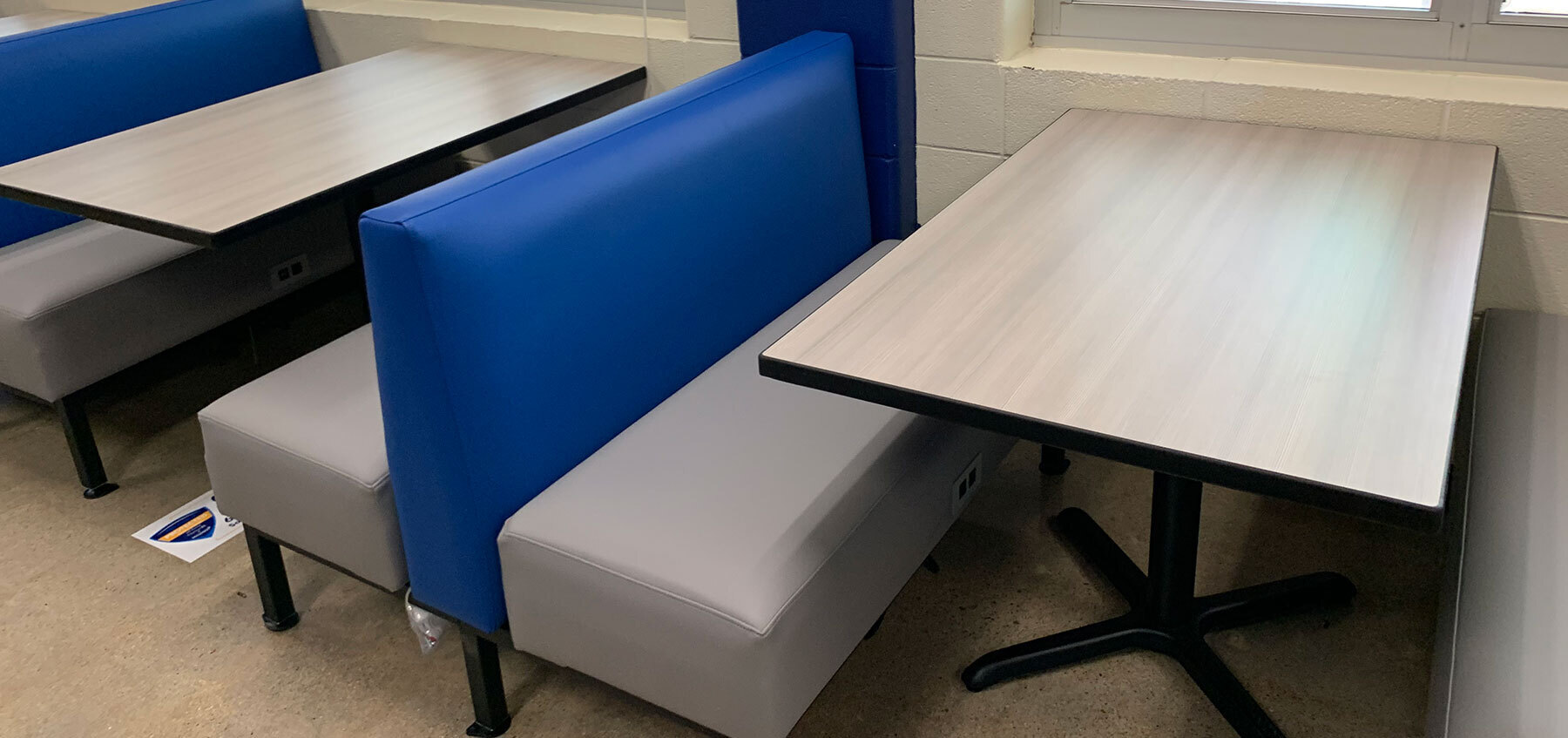 Durable booth and table works great in a school cafeteria, restaurants, dining rooms, and work break rooms.  These booths come in many different colors perfect for your brand or school colors.  Selecting the right table top for your restaurant or cafeteria is not only crucial for the design,  but also has a big impact on function and flow. Whether it be vinyl edge, wood edge, or other communal table options -- Plymold has plenty of options.