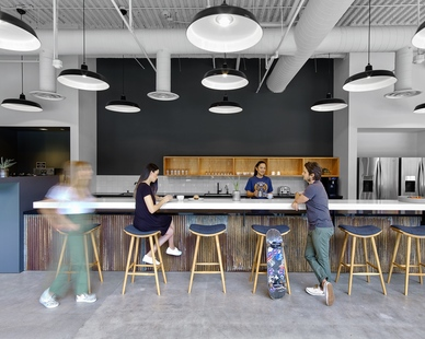 The comfortable and easily accommodating break area at the Vans corporate headquarters in Costa Mesa, California, featuring the Original™ Warehouse Pendant by Barn Light Electric. Photos by Eric Laignel