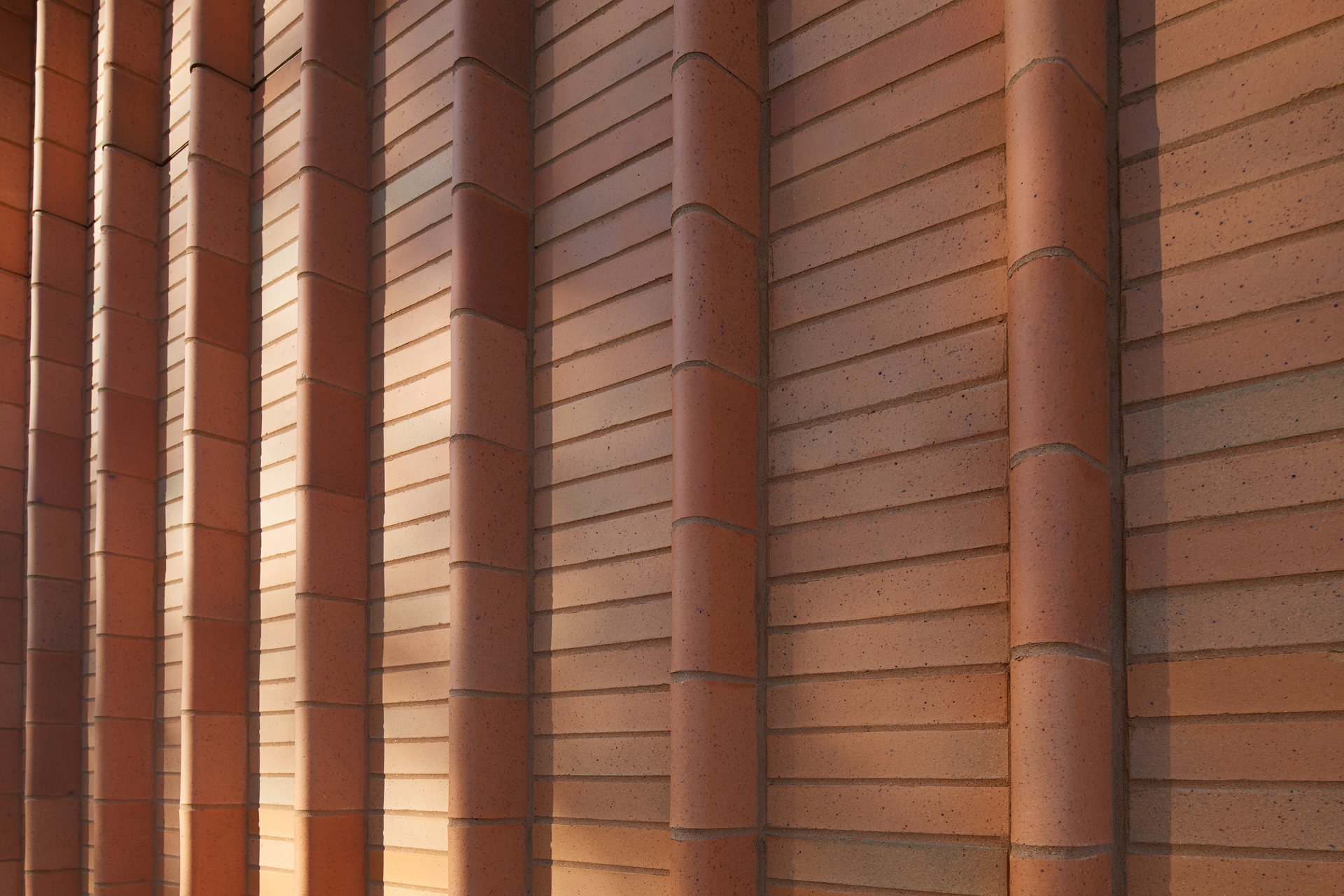 Custom brick fins and iron-spot brick was installed by The Belden Brick Company on the Kent State Center.