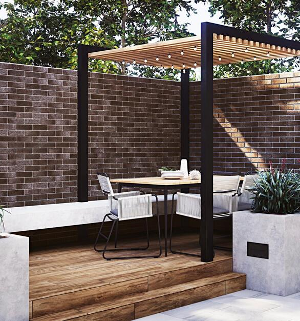 This outdoor patio is complete with a Thin Brick Panel and wood plank porcelain floor tile.