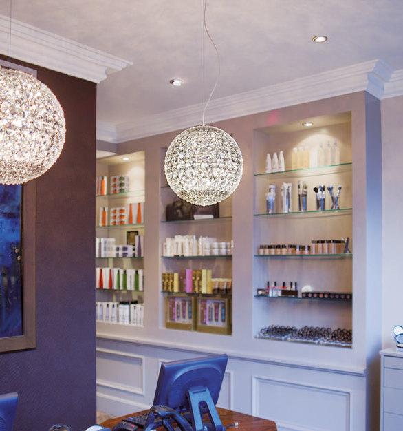 Two Da Vinci Balls by Swarovski Lighting beautifully reflect sunlight into the reception area of the Brown Sugar Salon.