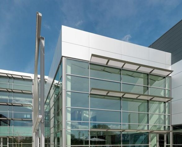 Located strategically outside the two-story public wing of the California ISO Headquarters in Folsom California, GKD metal fabric Omega 1510 provides solar control and daylighting for this west facing area.