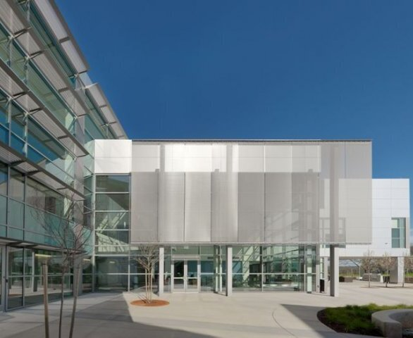 Located strategically outside the two-story public wing of the California ISO Headquarters in Folsom California, GKD metal fabric Omega 1510 provides solar control and daylighting for this west-facing area.