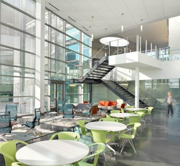 The interior of this office space is greatly benefiting from the sun shield properties of GKD Metal Fabrics' Omega 1510.