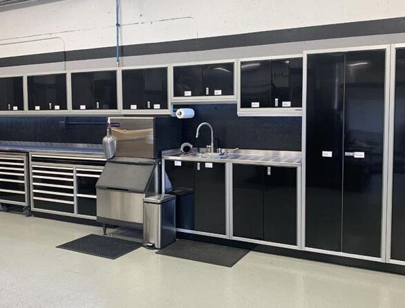 Moduline Cabinets at the Porsche Track Experience in Birmingham, Alabama.  A washstation, ice maker, and custom cabinets.