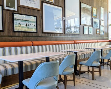 The Dalmar Hotel worked with Surfacing Solutions to create a beautiful solid wood accent wall in their cafe.  The solid tambour wood is created in panels for easy installation and can use any forms of stain.