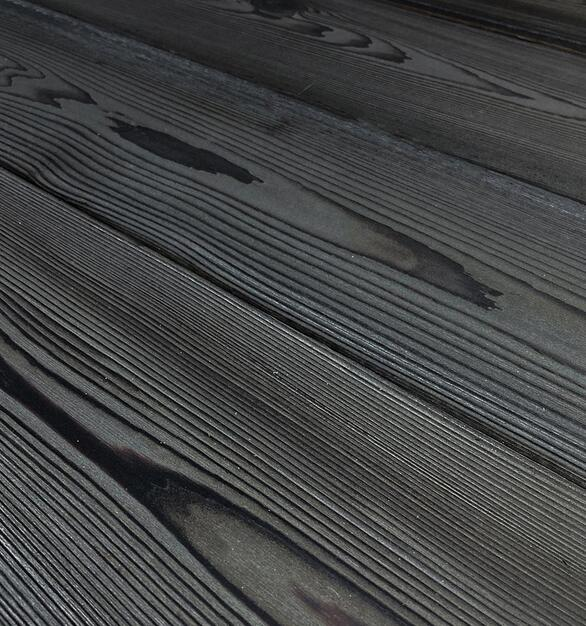 Shou Sugi Ban Western Red Cedar Charcoal by Pioneer Millworks. Charred wood siding and paneling that is burned, brushed twice, and coated with an exterior oil