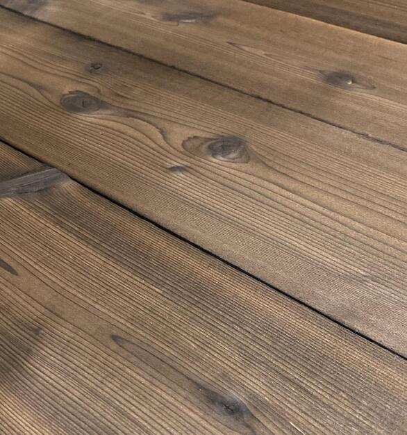 Shou Sugi Ban Western Red Cedar Undressed | 1 by Pioneer Millworks. Charred wood siding and paneling that is burned, brushed once, and left unfinished