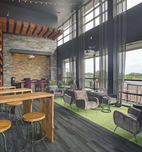 Helios Apartments in Atlanta, Georgia, features reclaimed wood paneling by Centennial Woods throughout the complex.