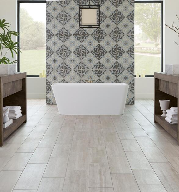 Mill Pointe Ronne Gris Wood Plank Ceramic Tile for the flooring in this bathroom makes a great addition, while the decorative pattern tile adds a fun accent.