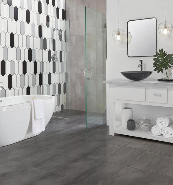 The multi-color ceramic wall tiles create a unique pattern in this modern bathroom.