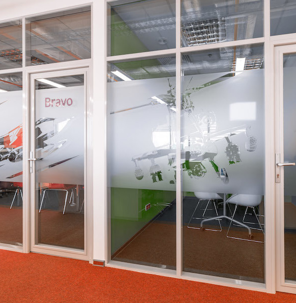 Certified Glass Partitions manufactured the glass dividers used in this office space.