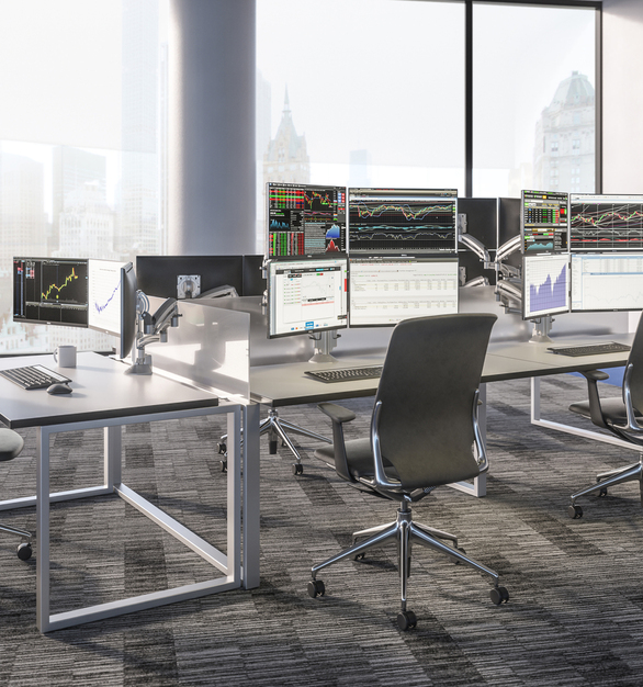 Cheif provided the workstation mounts used within this space to provide a wire-free and clean appearance to this open workspace.