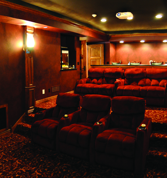 Two-story, intimate theater setting using a ceiling projector by Chief.