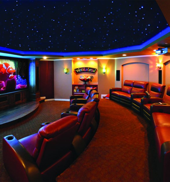 Seen here is a round, custom theater space showcasing Chief projector products.