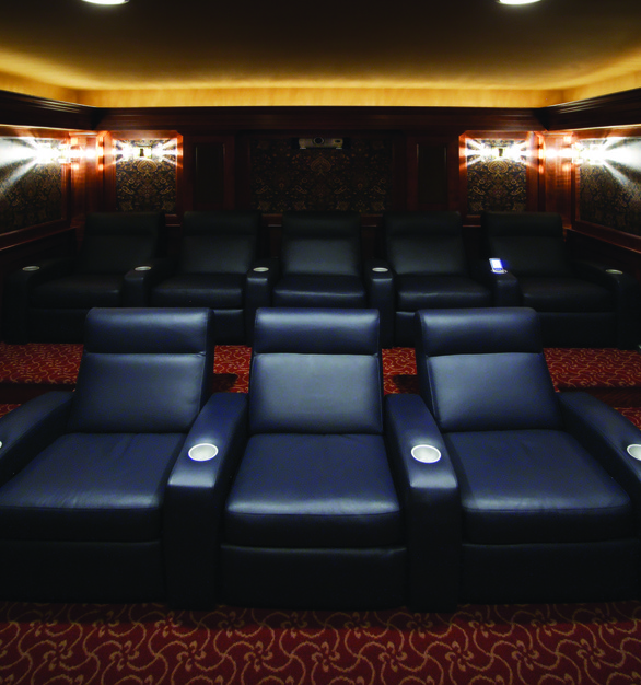 Small and intimate theater featuring a Chief projector to make the room complete.