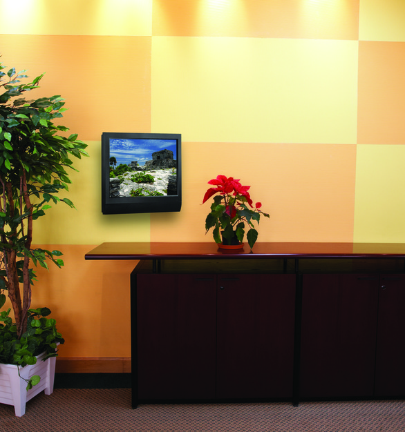 A flat panel TV using Chief's swing arm mount behind a reception desk is a great way to have mobility with signage for a company.